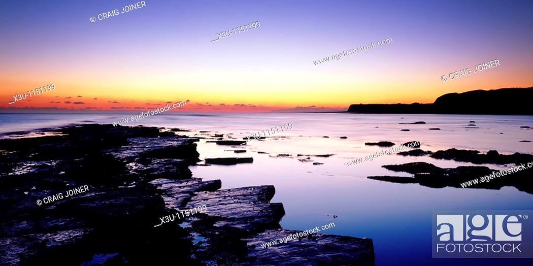 Stock Photo: Dusk over Kimmeridge Bay on the Dorset Jurassic Coast, Kimmeridge, Dorset, England, United Kingdom.