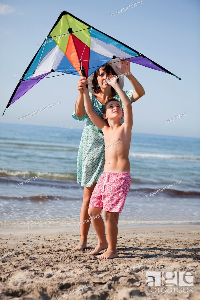 Stock Photo: mother and son flying a kite.