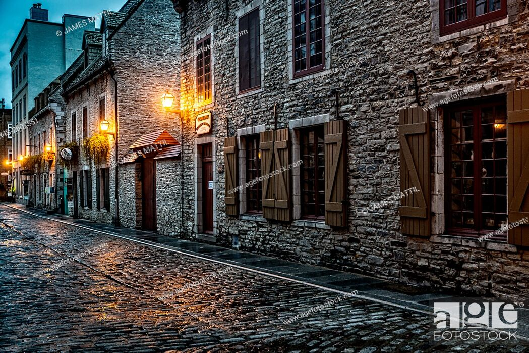 Stock Photo: Night Brings a romantic character to the old stone buildings of historic Quebec City. Founded in 1608, Quebec remains a walled fortress and a UNESCO World.