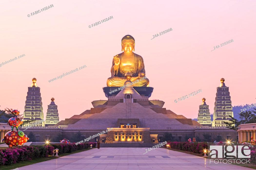 Stock Photo: Kaohsiung, Taiwan: Sunset at Fo Guang Shan, the biggest buddist temple of Kaohsiung in Taiwan, with a buddhist monk walking by.