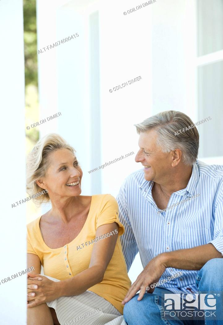 Stock Photo: Mature couple sitting together outdoors.