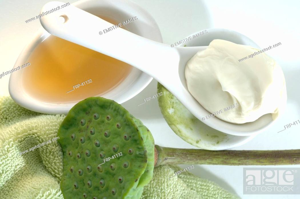 Stock Photo: Green tea in a spoon and vanishing cream.