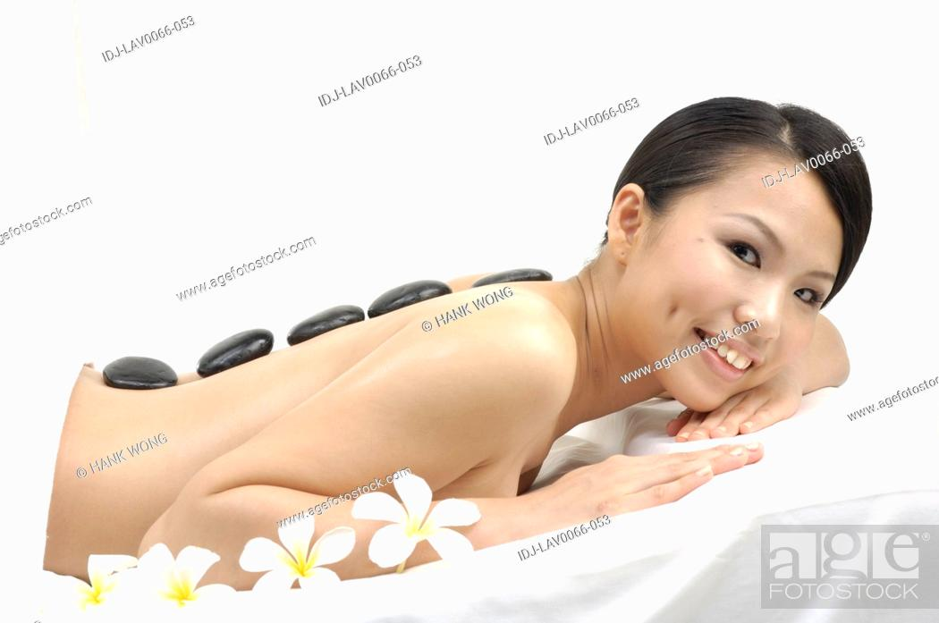Stock Photo: Woman getting lastone therapy.