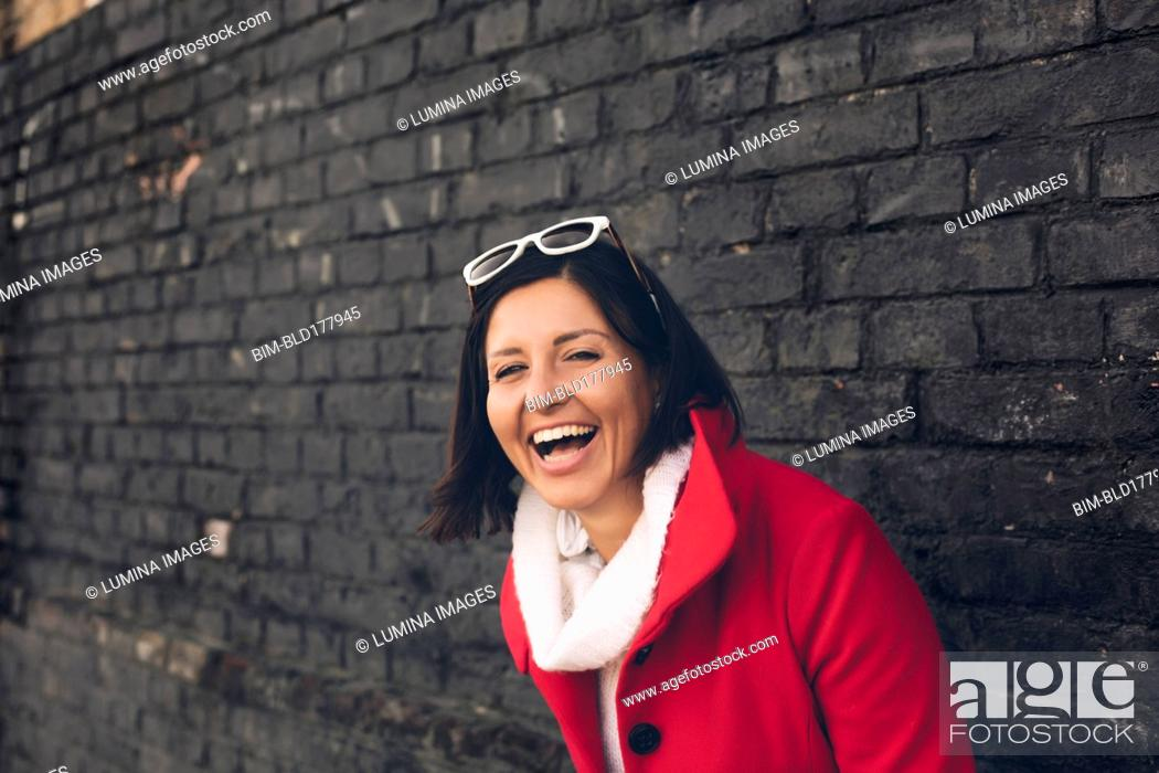Stock Photo: Caucasian woman laughing outdoors.