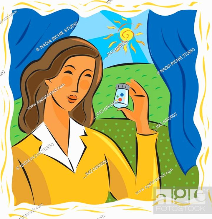 Stock Photo: Woman looking at a bottle of pills.