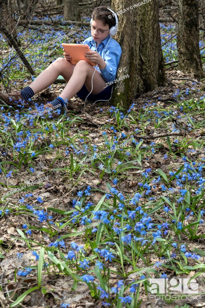 Stock Photo: Russia. Teen twelve years in the spring forest.