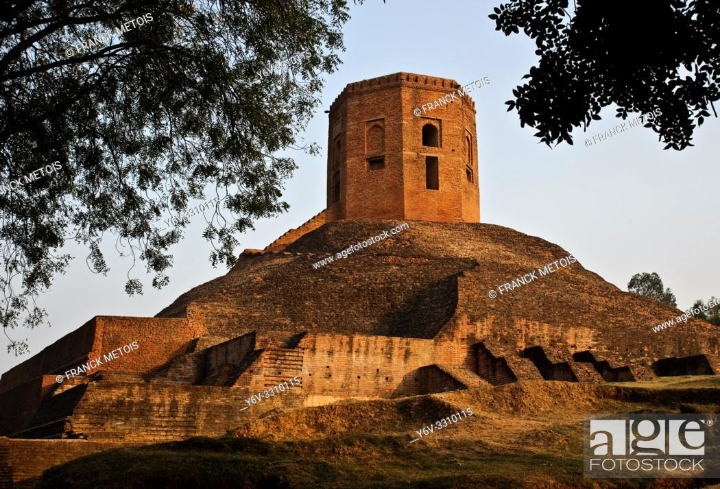 Stock Photo: Chaukhandi stupa ( Sarnath, India). The stupa has been built ( between the 4° and 6° century) at the place where Buddha met his first five disciples after.