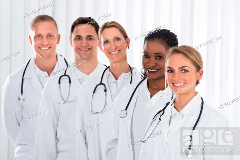 Stock Photo: Team Of Happy Medical Practitioner Standing In A Line.