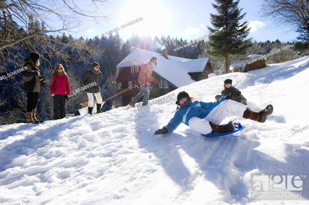 Stock Photo: Children playing in snow, St Peter, Black Forest, Baden-Wurttemberg, Germany.