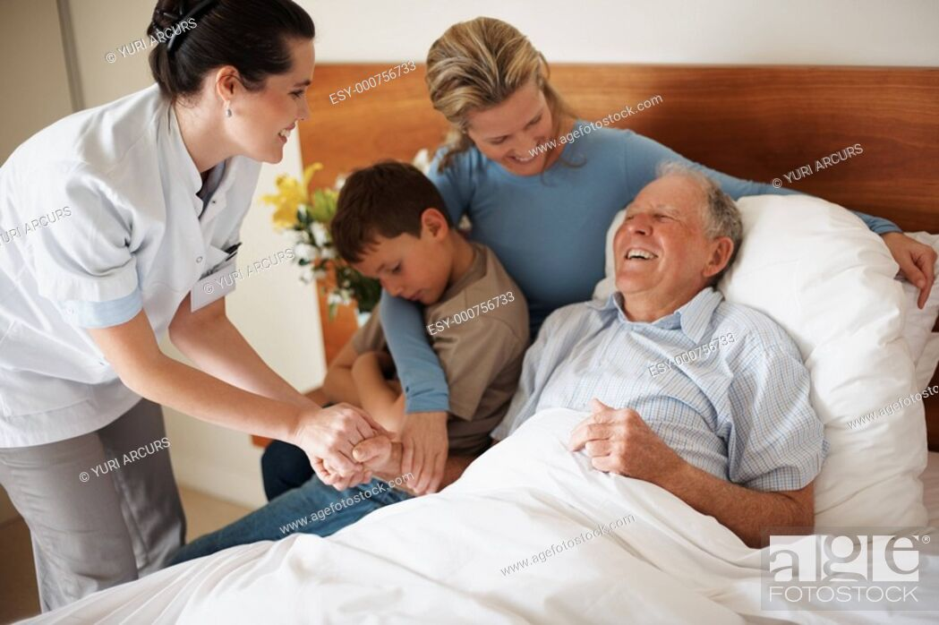 Stock Photo: Recovered old man visited by family and doctor at the hospital.