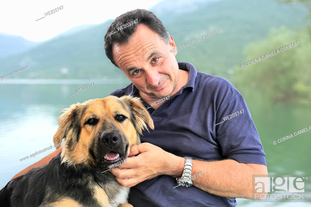 Stock Photo: Portrait of a man together with his adopted dog.