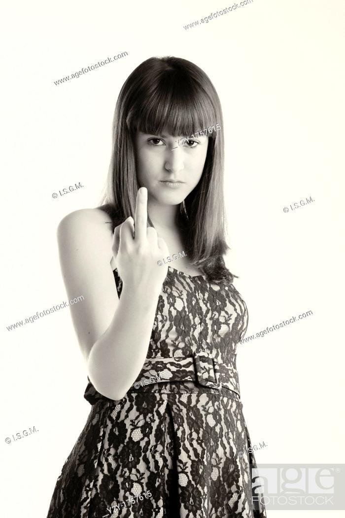 Stock Photo: Girl lifting the ring finger.