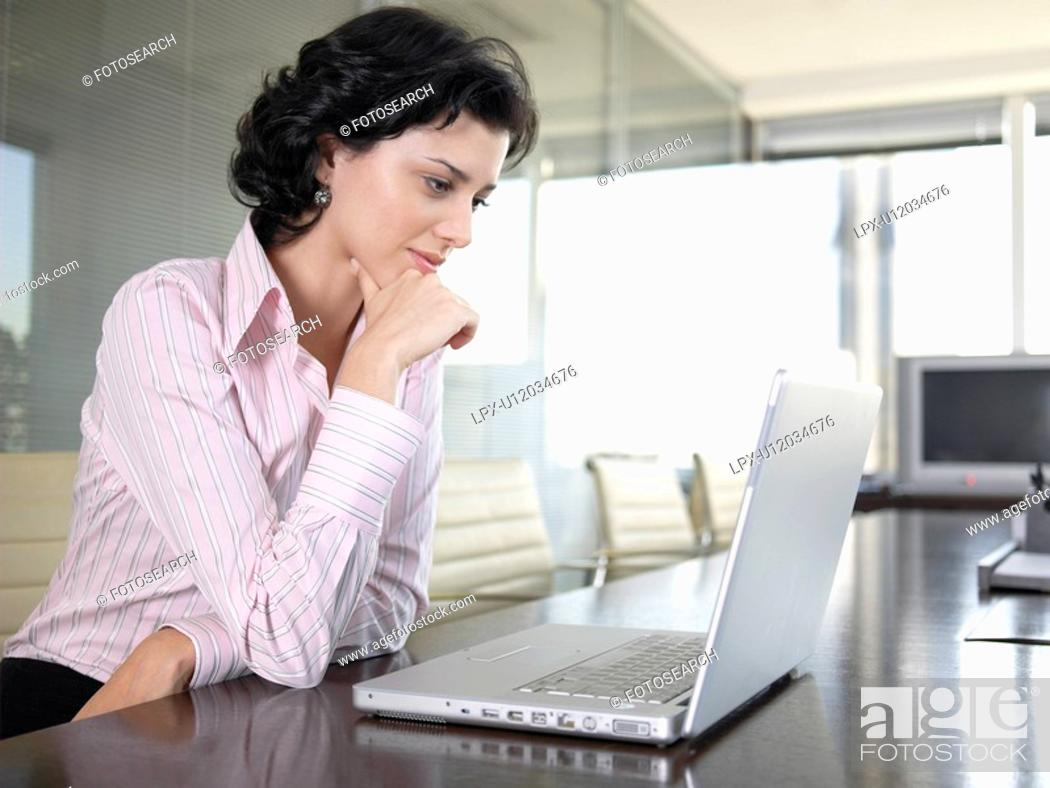 Stock Photo: Young businesswoman working on computer.