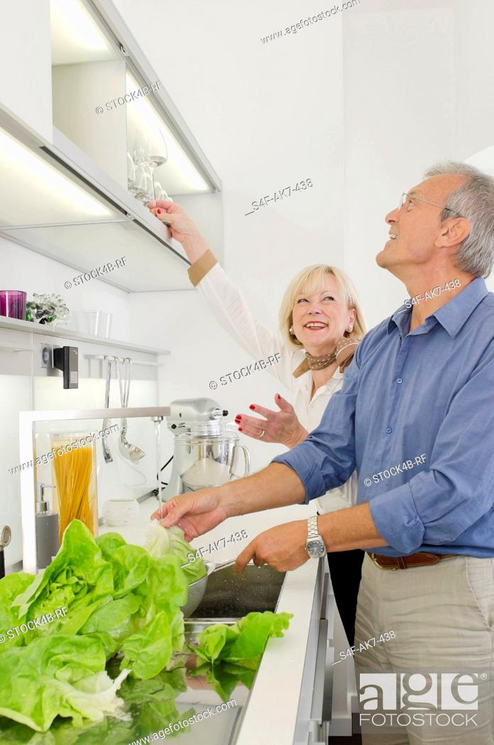 Stock Photo: Senior couple preparing healthy meal in kitchen.