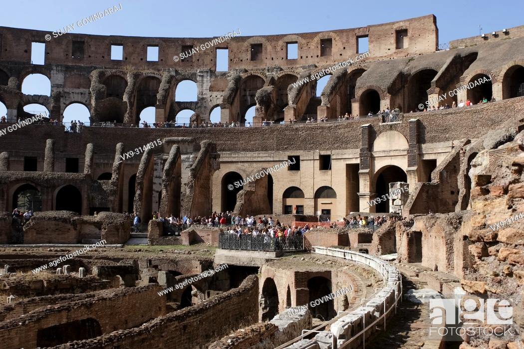 Stock Photo: Rome, Italy - October 13, 2017: Tourists from around the world visiting one of ancient wonders, the famous Colosseum of Rome in Italy.