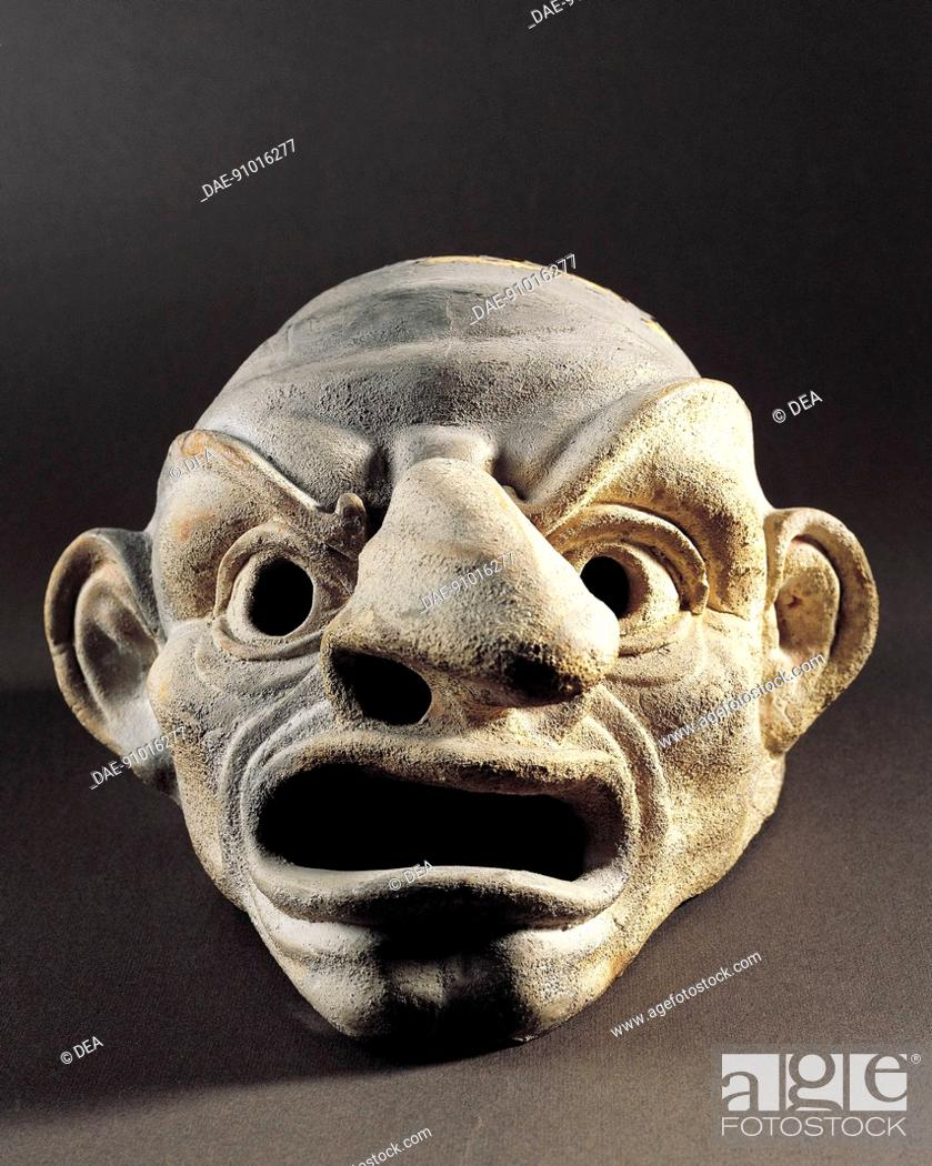 Stock Photo: Life-size theatrical mask, terracotta sculpture unearthed in Apulia, Italy. Ancient Greek civilization, Magna Graecia, 5th-2nd Century BC.