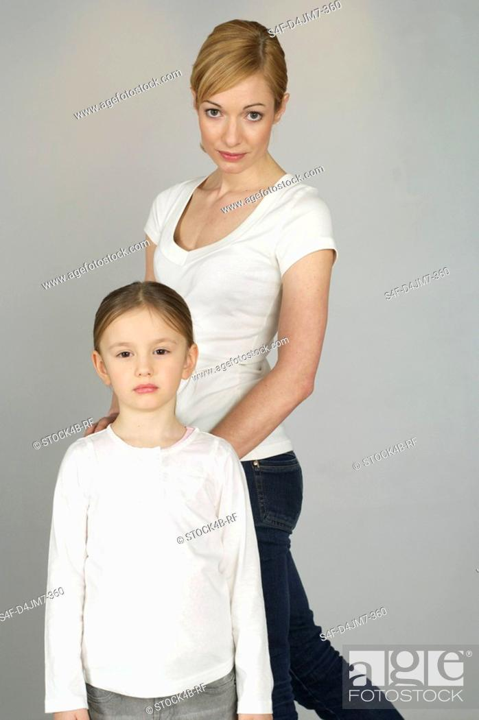 Stock Photo: Mother and daughter looking at camera.