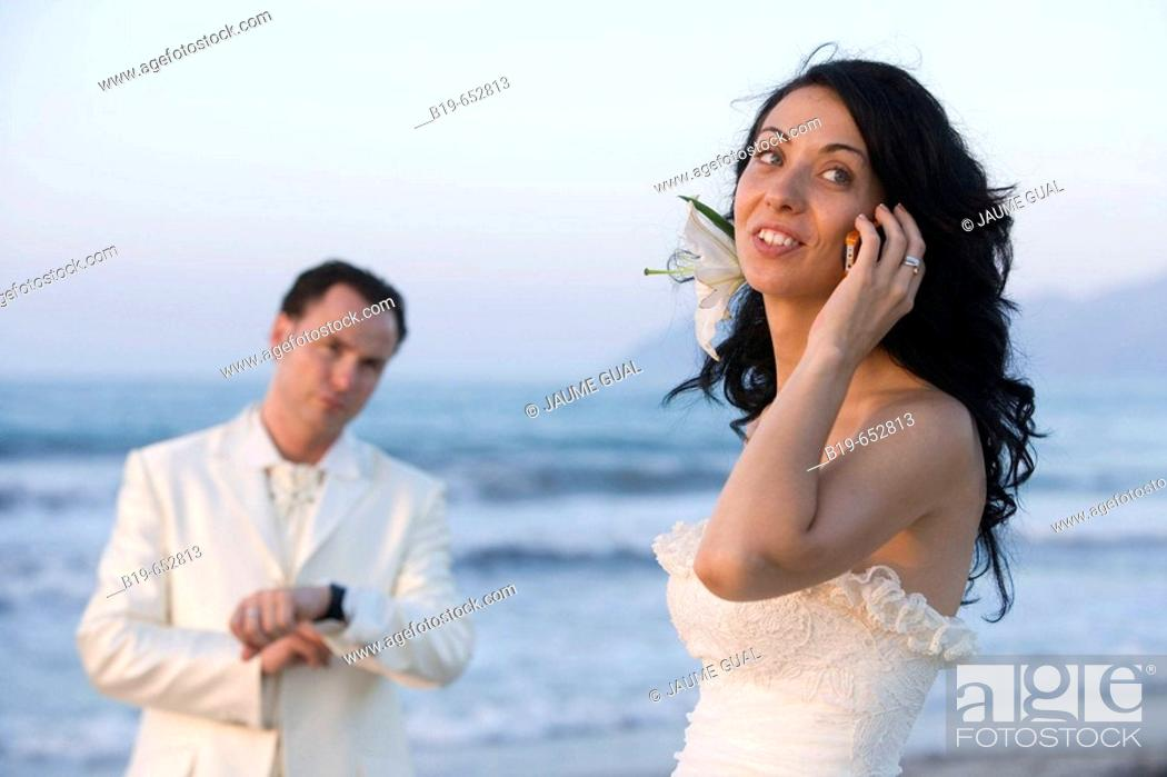 Stock Photo: Newly married couple on the beach.
