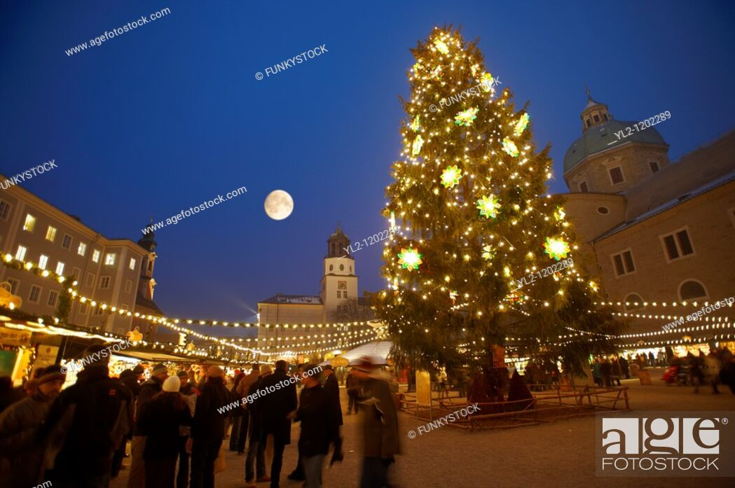 Stock Photo: Christmas market stalls and Christmas tree at night at Satlzburgh market - Austria.