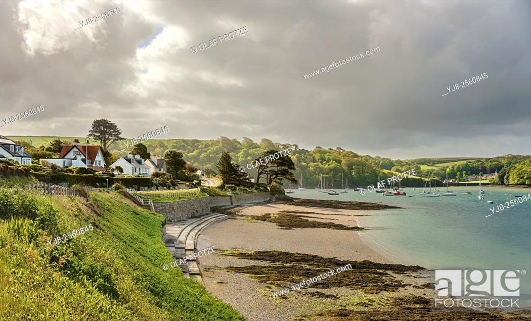 Stock Photo: Dramatic cloud formation at the coastline of the fishing village St. Mawes at the Cornish Coast near Falmouth, Cornwall, England, UK.