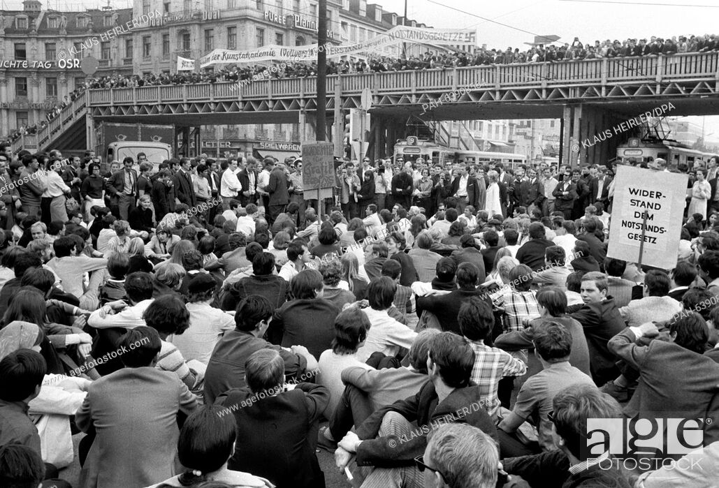 Stock Photo: Demonstrators block the tram lines at Stachus in Munich. Thousands of students, workers and employees demonstrated on 29 May 1968 against the third reading of.