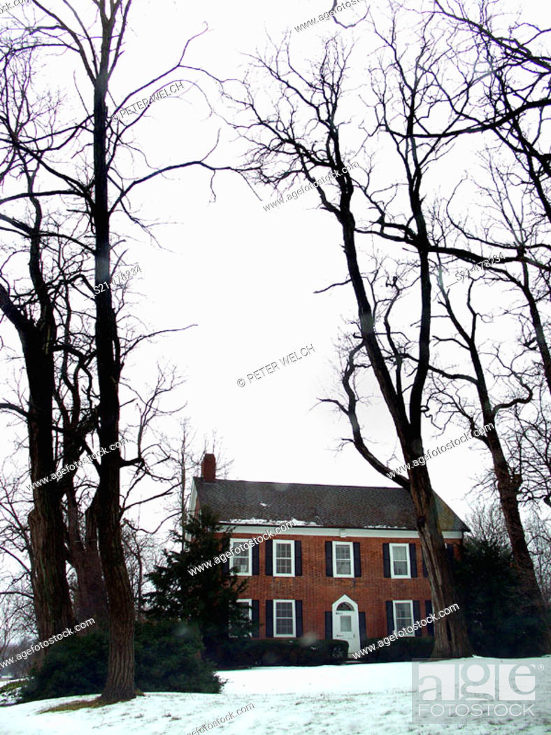 Stock Photo: A  contry, colonial house in Upstate, New York is captured in  Winter.
