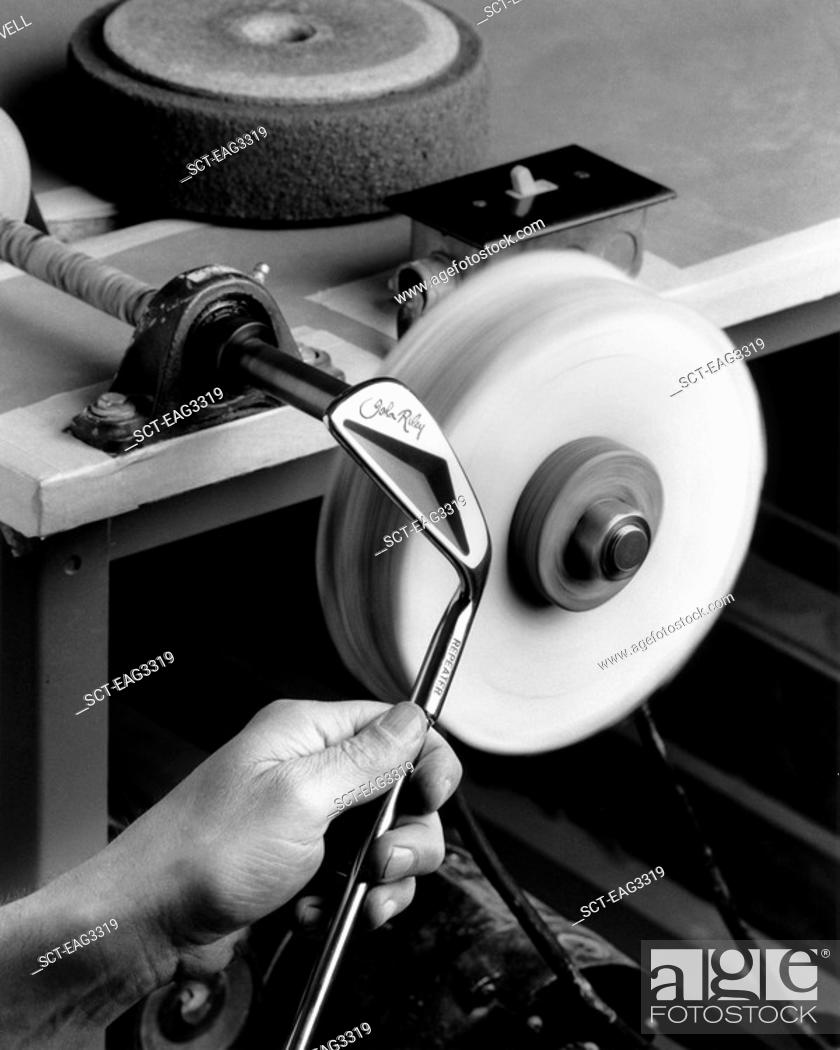 Stock Photo: Polishing a putter at a GOLF CLUB FACTORY which makes clubs by hand.