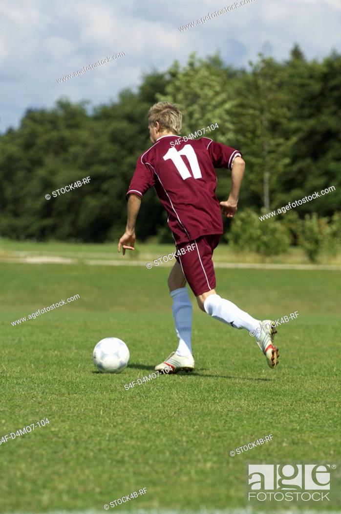 Stock Photo: Kicker playing the ball.