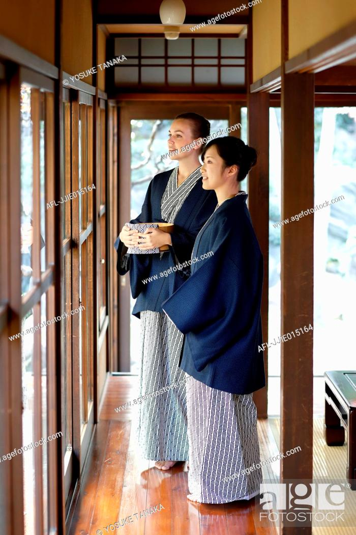 Stock Photo: Caucasian woman wearing yukata with Japanese friend at traditional ryokan, Tokyo, Japan.