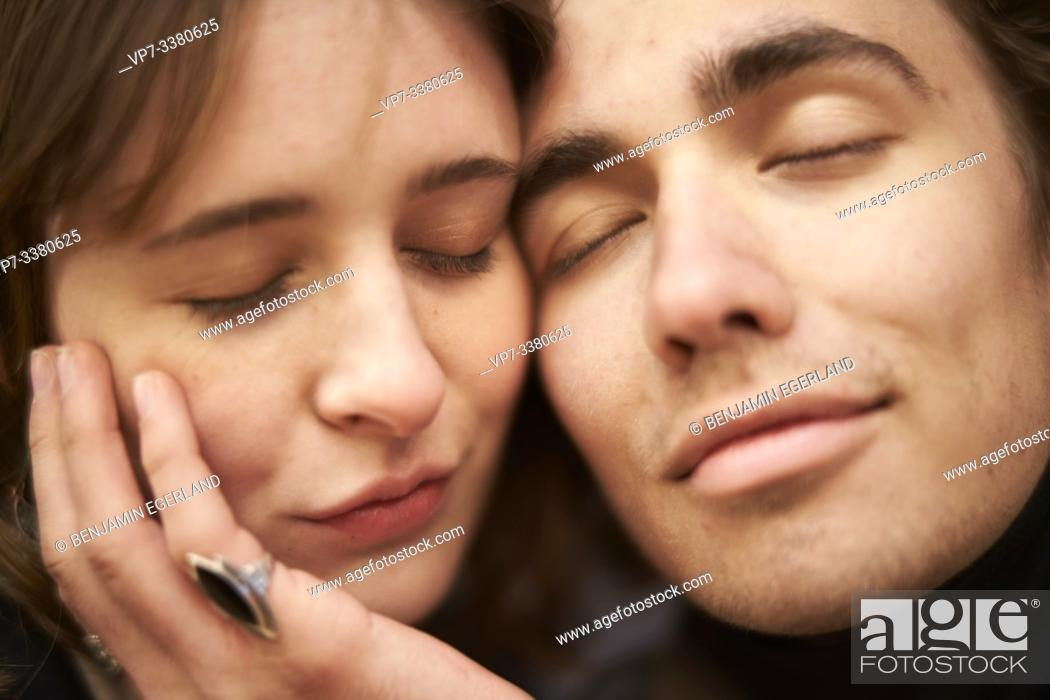 Stock Photo: fond couple with closed eyes.