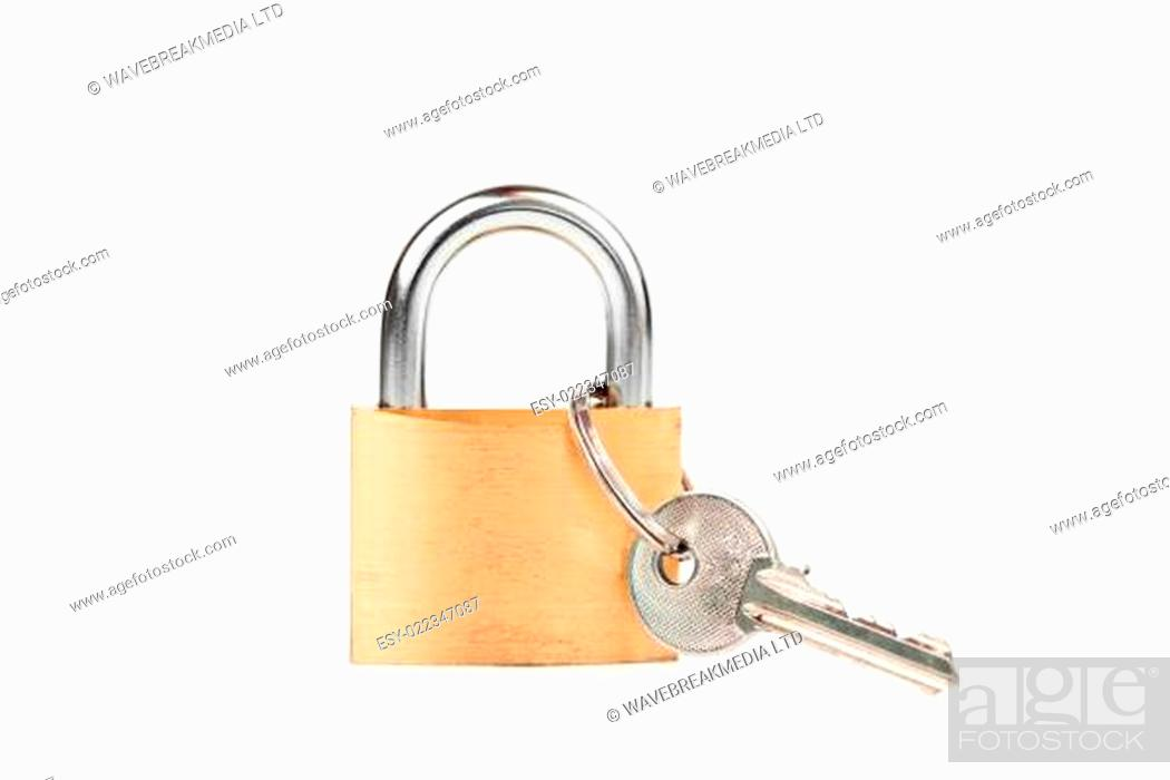 Photo de stock: Padlock standing with key hanging against white background.