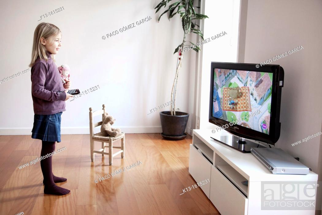 Stock Photo: Girl watching TV at home.