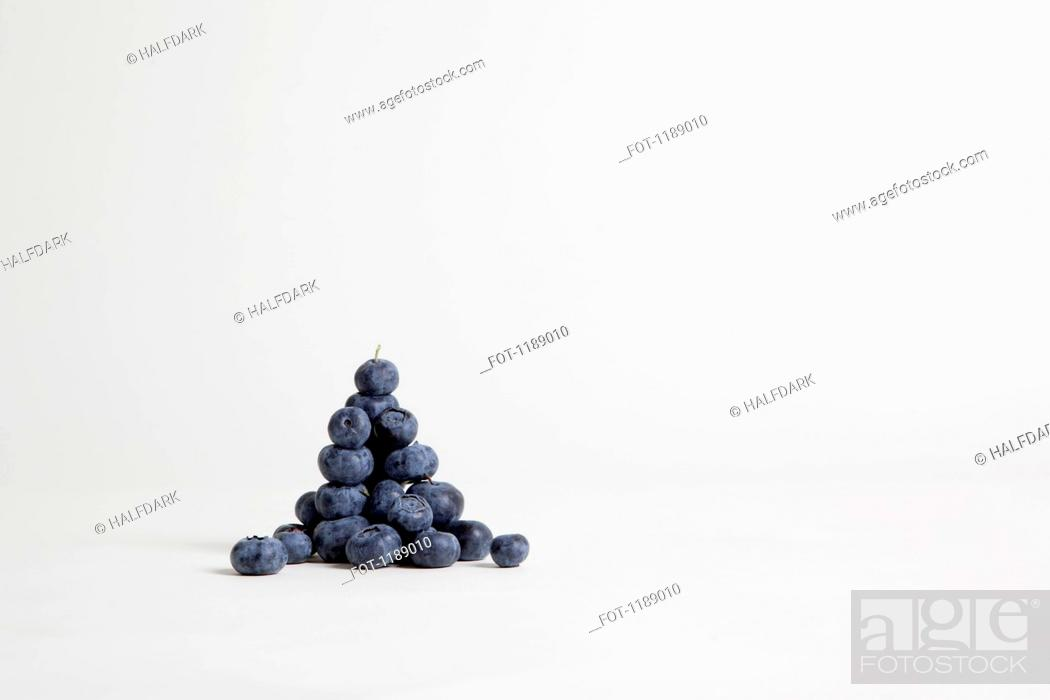 Stock Photo: A heap of blueberries, studio shot.