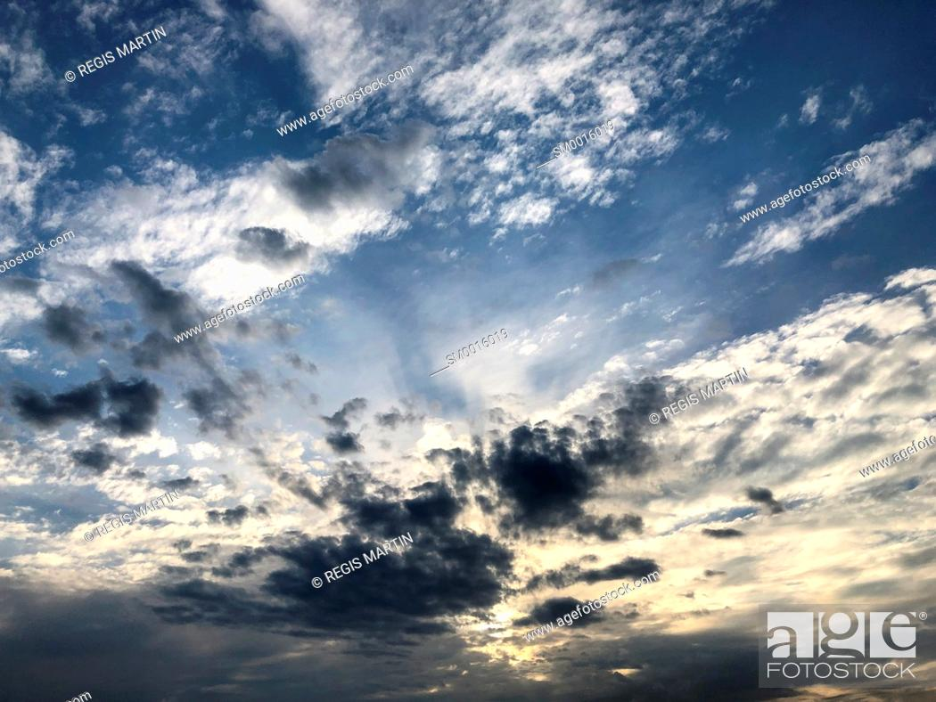 Stock Photo: Clouds and sunlight.