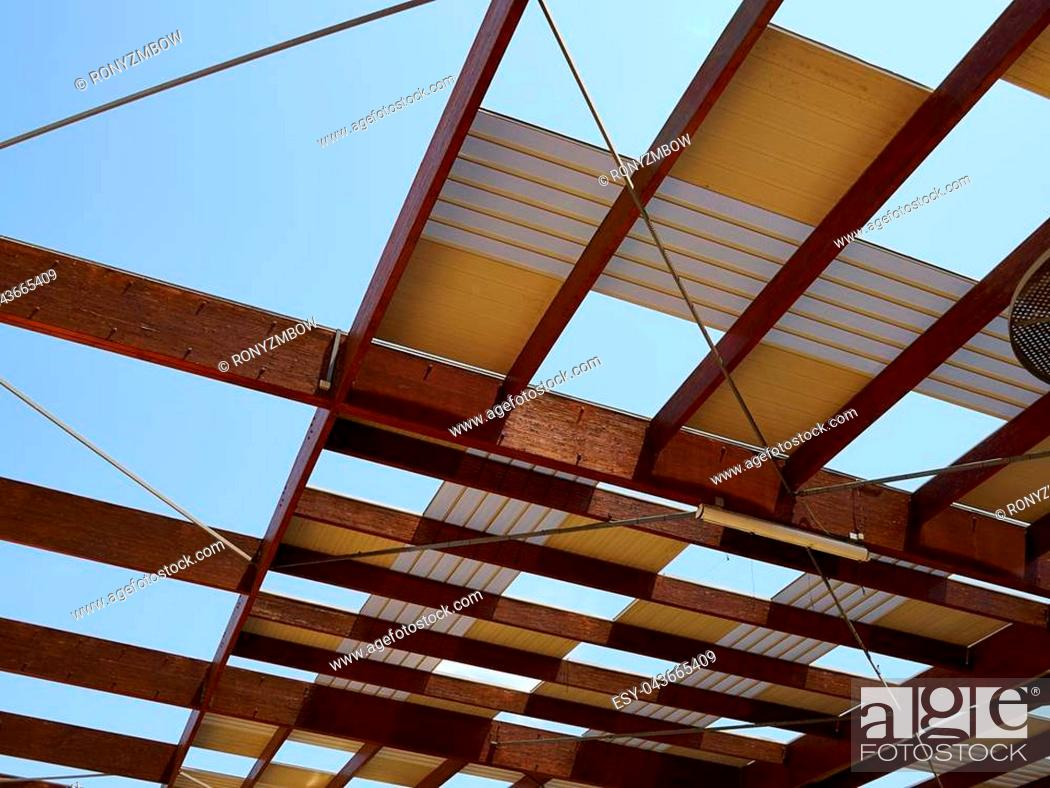 Stock Photo: Modern design pergola arbor made wood and metal with clear blue summer sky background.