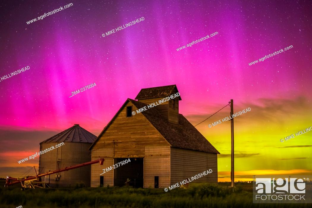 Stock Photo: Nothern lights dance above the Iowa landscape.