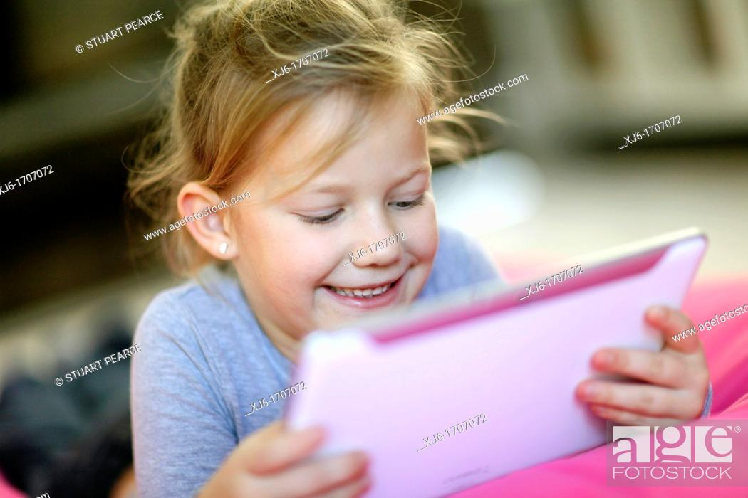 Stock Photo: Girl using tablet computer.