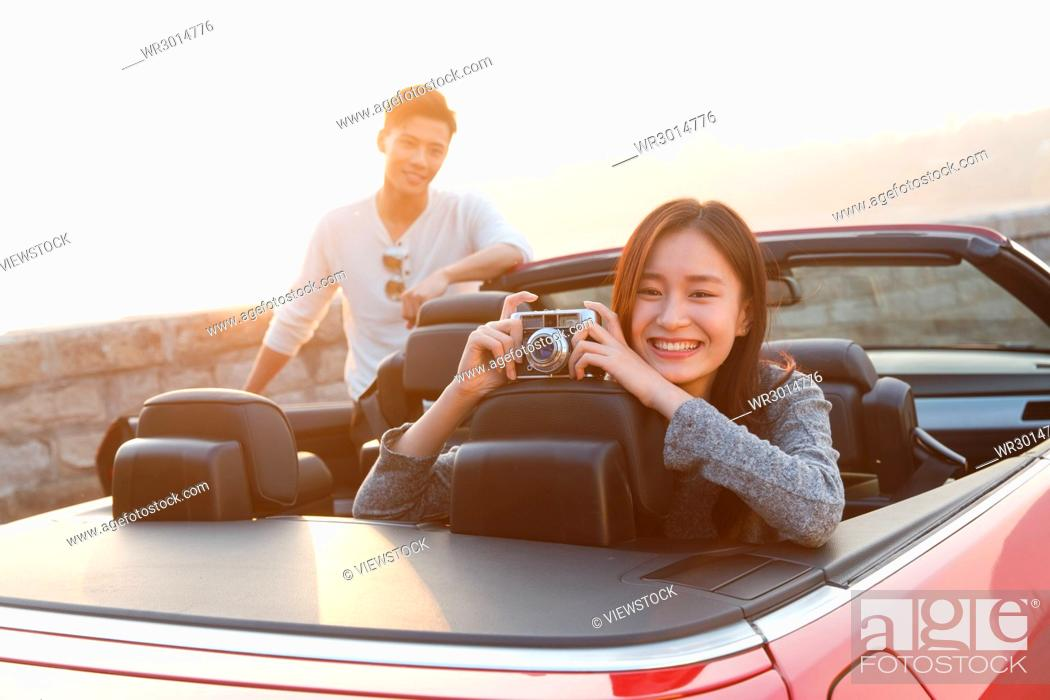 Stock Photo: Young couple driving.