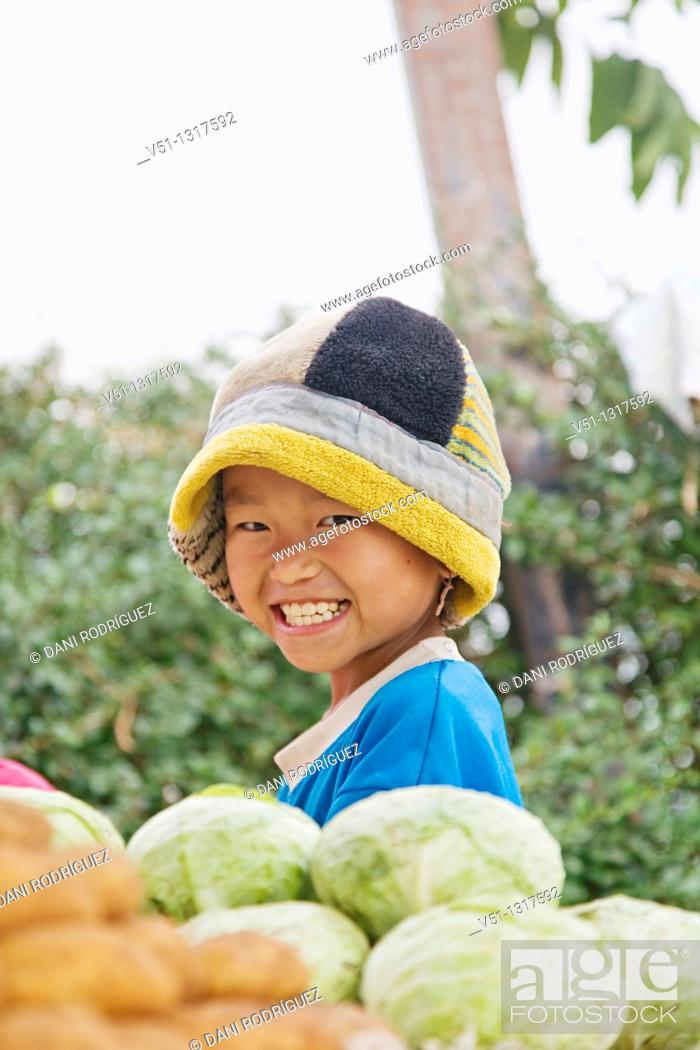 Stock Photo: Portrait of a smiling boy in a market in Pai, Nord Thailand.