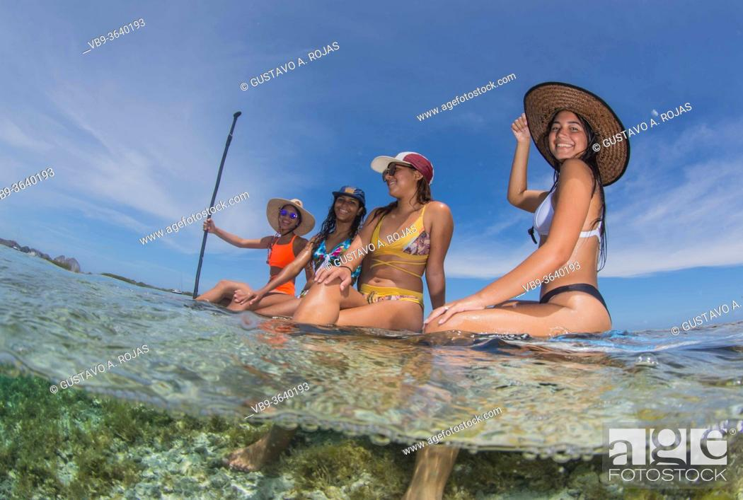 Stock Photo: Group Beautiful Women on Paddle Board enjoying Sports in sunny day. Travel detination Caribbean Beach in Los Roques Venezuela.