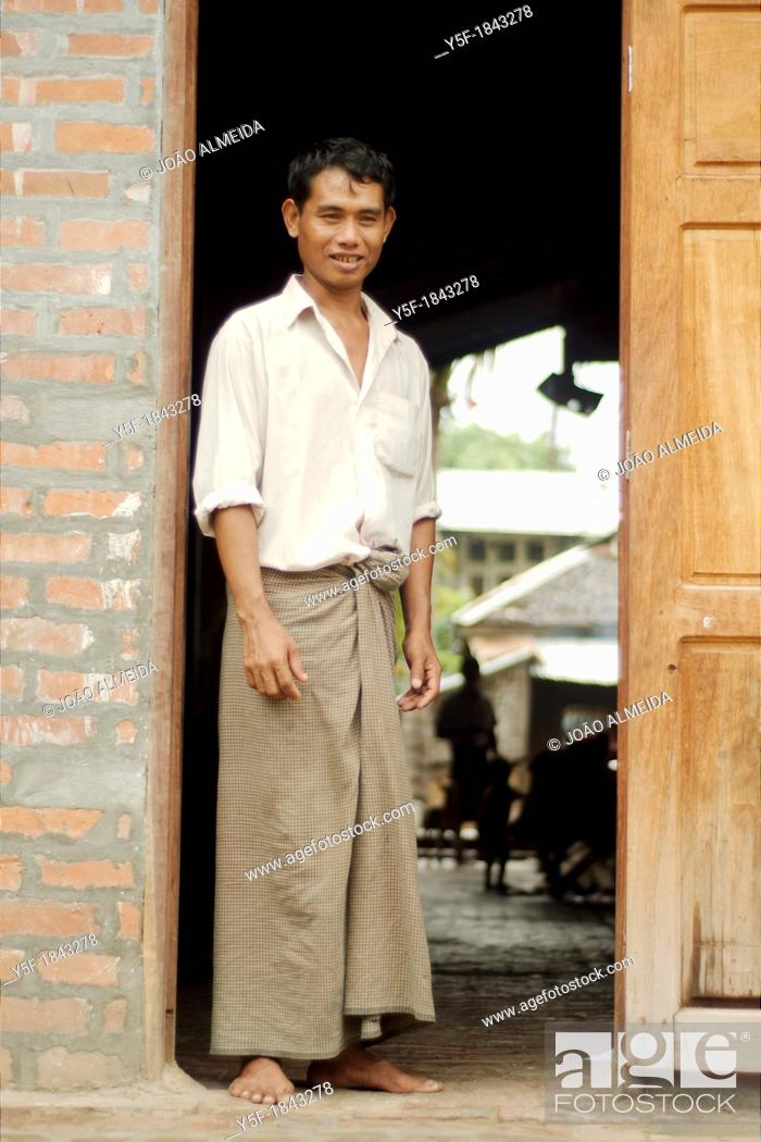 Stock Photo: Worker at the door of his workshop at Mandalay.