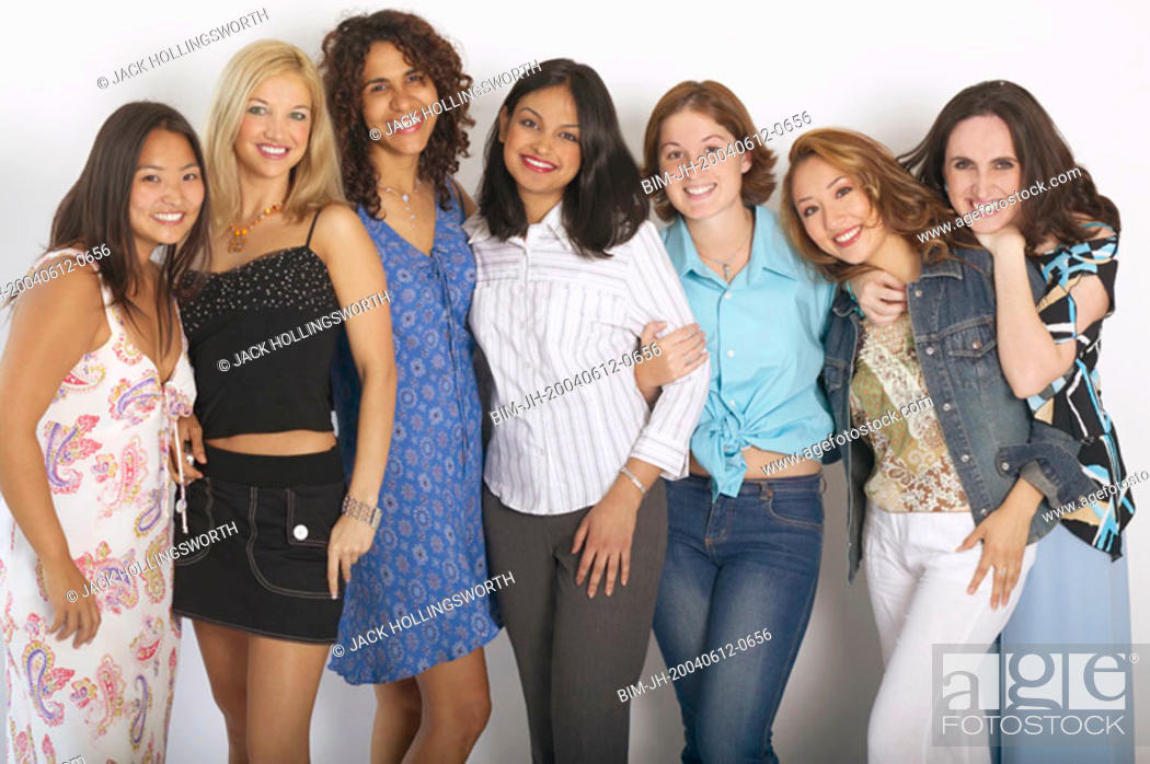 Stock Photo: Large group of women hugging and smiling.