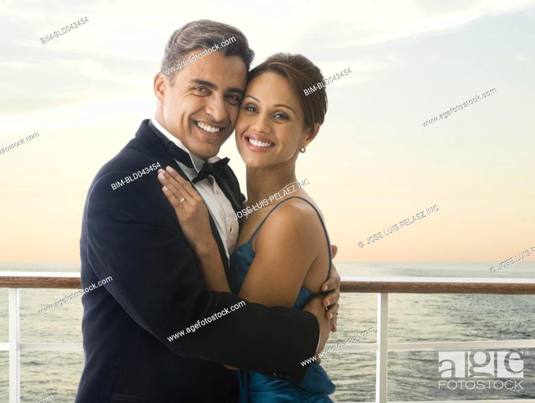 Stock Photo: Hispanic couple in eveningwear on ship.