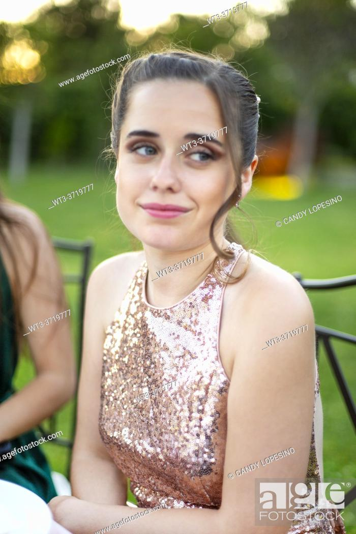 Stock Photo: A pretty girl in an elegant light pink champagne colored dress at a wedding.