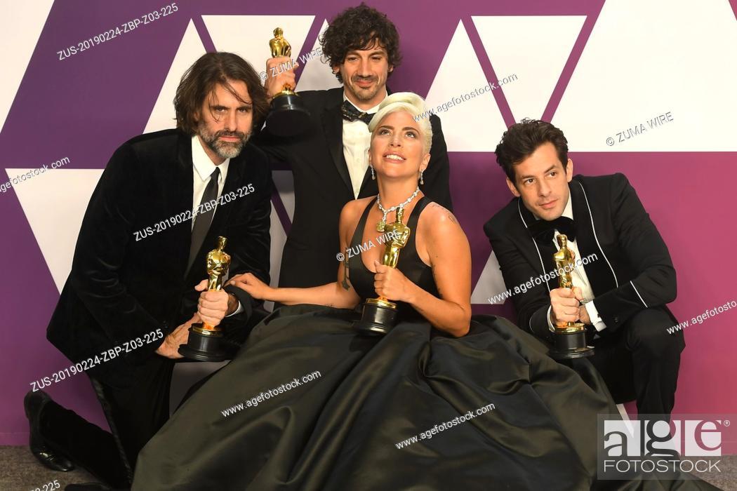 Stock Photo: February 24, 2019 - Los Angeles, California, U.S - ANDREW WYATT, ANTHONY ROSSOMANDO, LADY GAGA AND MARK RONSON in the Press Room during the 91st Academy Awards.