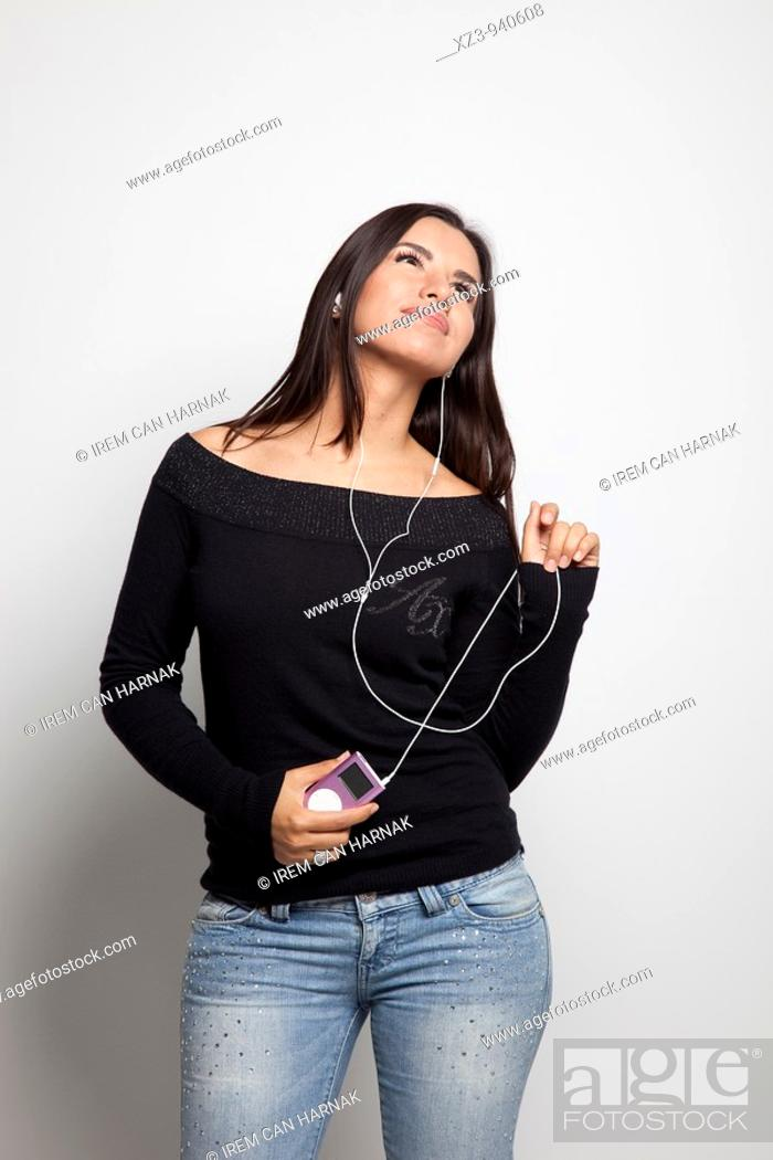 Stock Photo: Studio portrait of young woman.