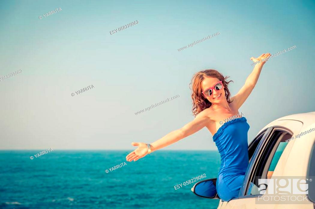 Stock Photo: Happy woman travel by car. Person having fun on the beach. Summer vacation concept.