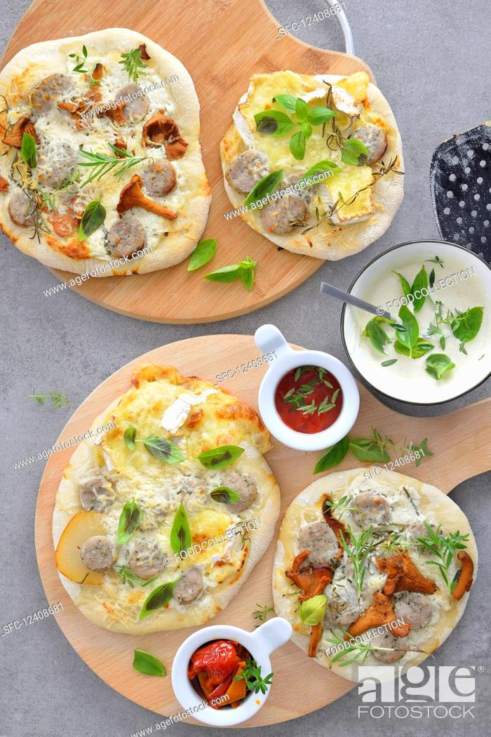 Stock Photo: Mini pizzas with mushrooms pear basil white sausage served with tomato sauce.