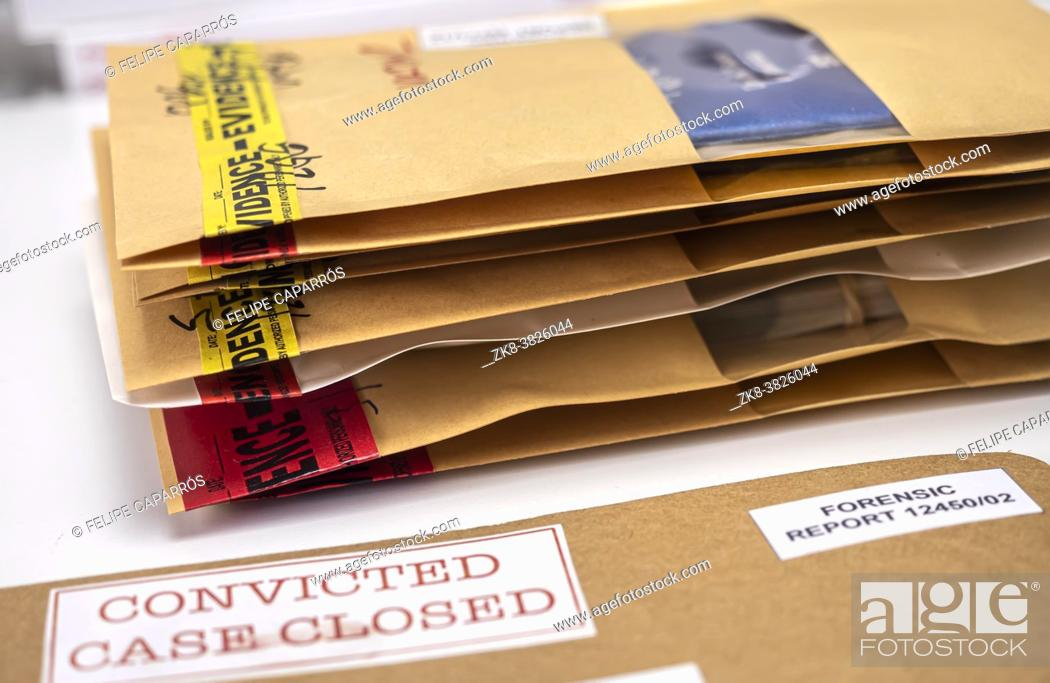 Photo de stock: Files and evidence bag in a crime lab, conceptual image.