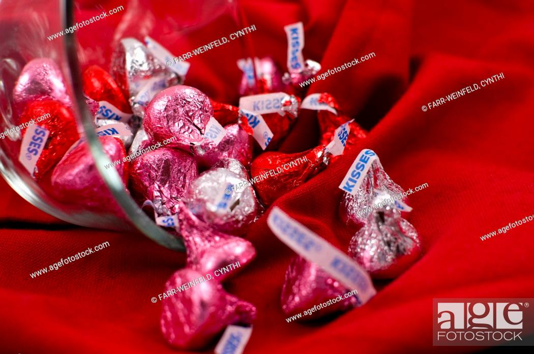 Stock Photo: Pink, Red and Silver Chocolate Kisses Spilling From a Bowl.